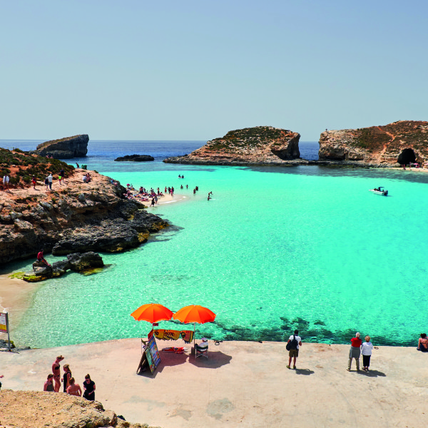 Blue Lagoon on a sunny day in APRIL 13, 2016 in Comino island, Malta.